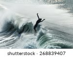Silhouette Of Surfer Hit From...