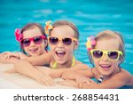 happy children in the swimming... | Shutterstock . vector #268854431