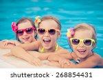 happy children in the swimming... | Shutterstock . vector #268854431