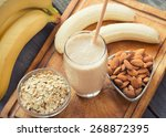 fresh made banana smoothie on... | Shutterstock . vector #268872395