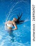 beautiful girl and water... | Shutterstock . vector #268906907
