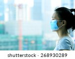 asian woman wear face mask in... | Shutterstock . vector #268930289