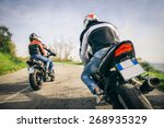 Two Motorbikes Driving In The...