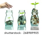 mix coins and seed in clear... | Shutterstock . vector #268989905