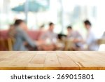 wood table top with blurred... | Shutterstock . vector #269015801