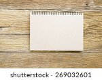 notebook  on wooden table | Shutterstock . vector #269032601