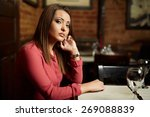 sad beautiful lady sitting in a ... | Shutterstock . vector #269088839