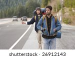two campers hitchhiking on a... | Shutterstock . vector #26912143