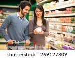 young couple choosing food in a ... | Shutterstock . vector #269127809