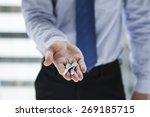 Smiling businessman giving keys ...