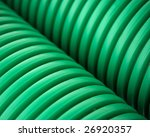 Close up of green plastic pipes - stock photo