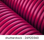 Close up of red plastic pipes - stock photo