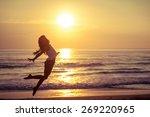 happy little girl jumping on... | Shutterstock . vector #269220965