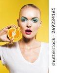 cute woman with slice of orange ... | Shutterstock . vector #269234165
