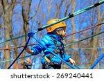 little boy climbing in... | Shutterstock . vector #269240441
