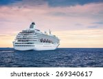 Big Cruise Ship In The Sea At...