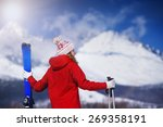 Young Woman Skiing Outside In...