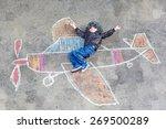 happy little kid boy in pilot...   Shutterstock . vector #269500289