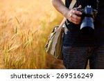 photographer holding camera on... | Shutterstock . vector #269516249