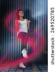 Small photo of Fit woman doing aerobic exercise against dark grey room