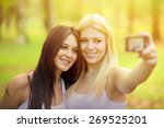 Outdoor Portrait Of Two Girl...