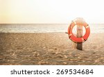 life preserver on sandy beach...