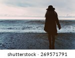 young woman in a black coat on... | Shutterstock . vector #269571791