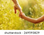 a parent holds the hand of a... | Shutterstock . vector #269593829