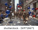 Soldiers in tickertape parade ...