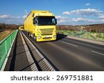two yellow trucks driving... | Shutterstock . vector #269751881
