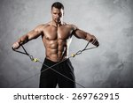 brutal athletic man pumping up... | Shutterstock . vector #269762915