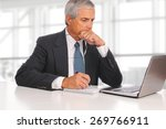 mature businessman seated at... | Shutterstock . vector #269766911