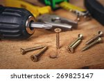 screw being screwed into a... | Shutterstock . vector #269825147