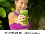 Athletic Girl Holding A Green...