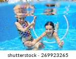 Happy Children Swim In Pool...