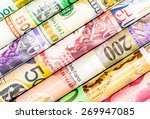 Stock photo a backgrounds with colorful of many roll currency money from many country 269947085