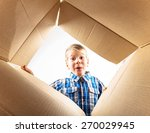 child opening cardboard box and ... | Shutterstock . vector #270029945