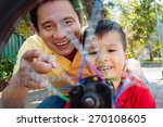 cheerful asian father and his... | Shutterstock . vector #270108605