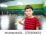 Little Boy Taking Badminton...