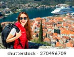 young woman traveler in red... | Shutterstock . vector #270496709