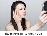 woman checking her wrinkles | Shutterstock . vector #270574805