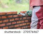 workers masonry clay brick to... | Shutterstock . vector #270576467
