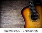 Guitar Against A Rustic Wood...
