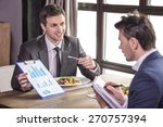 smiling businessmen analyzing... | Shutterstock . vector #270757394