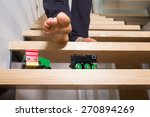 close up of man's foot and toys ... | Shutterstock . vector #270894269