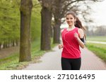 Young Beautiful Woman Running...
