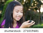 Asian Little Girl With A Mobile ...