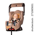 Small photo of Baby doll in an opened booster seat for a car on white background