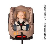 Small photo of Baby doll fastened in a booster seat for car on white background