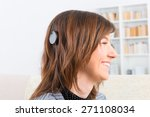 Young  Smiling Woman Showing...